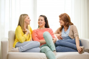 friendship and happiness concept - three girlfriends having a ta